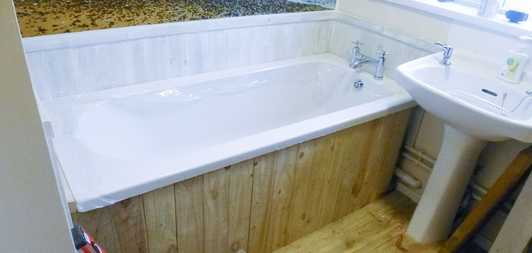 how to remove a bathtub without damaging tiles