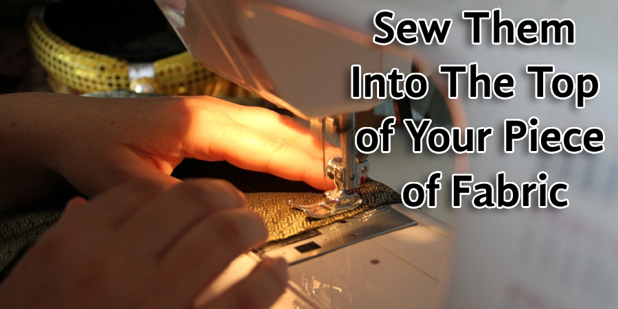 Sew them into the top of your piece of fabric