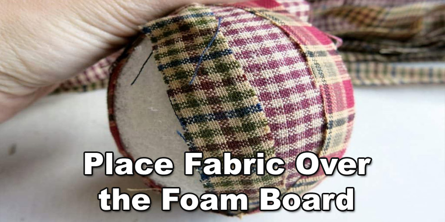 Place the fabric over the foam board