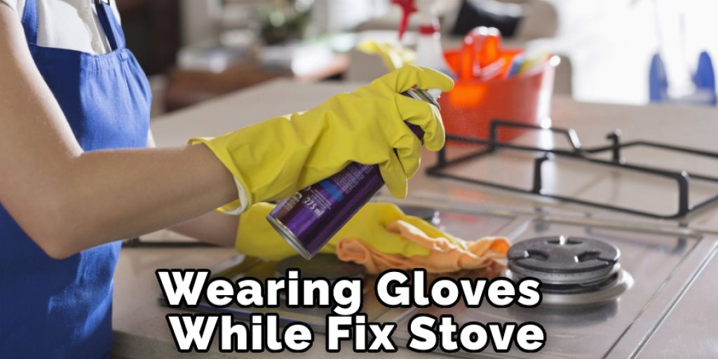 Wearing Gloves While Fix Stove