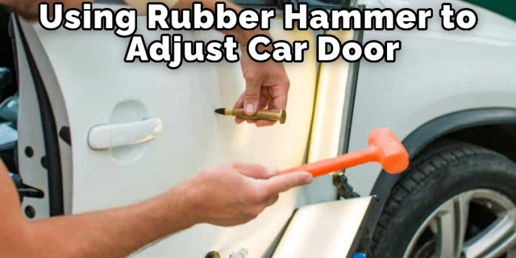 Using Rubber Hammer to Adjust Car Door