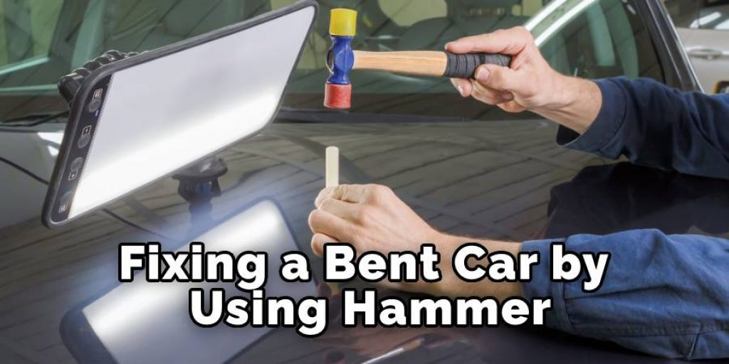 Fixing a Bent Car by Using Hammer