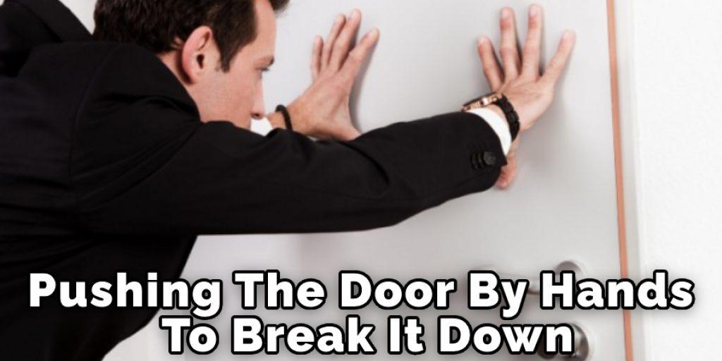 Pushing The Door By Hands To Break It Down