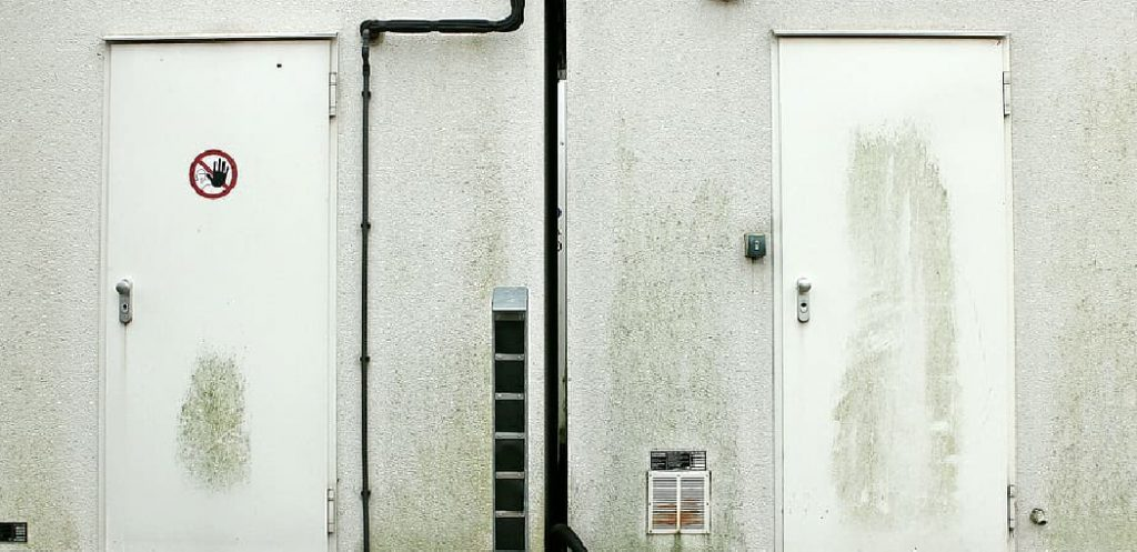 How to Fix a Metal Door That Rubs at the Bottom