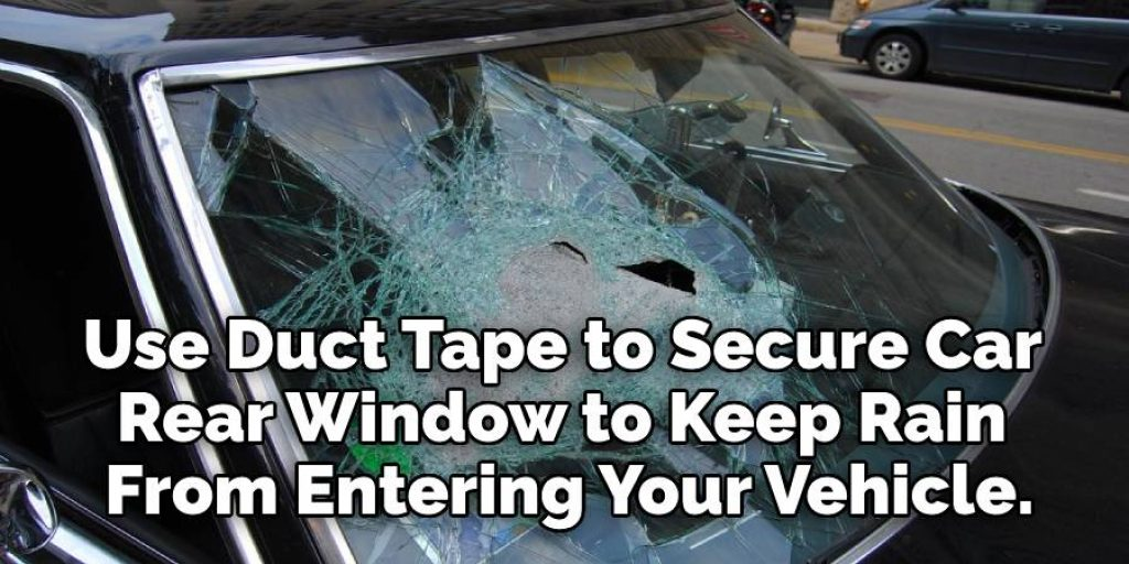 Duct Tape to Secure  Car Rear Window to Keep Rain  From Entering Your Vehicle.